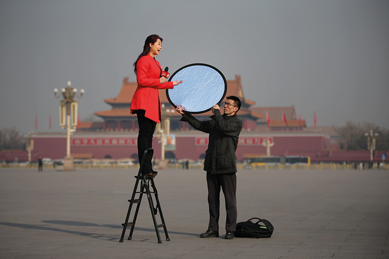 A reporter at work in Beijing, China