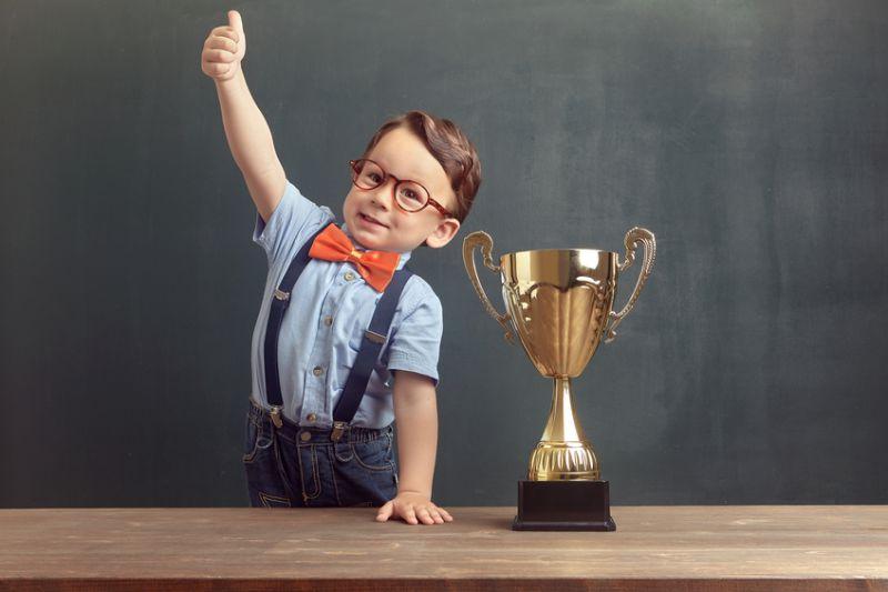 Baby winning trophy