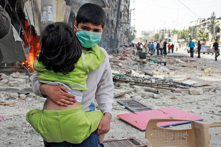 Boy carries girl, Bustan al-Qasr, Aleppo, Syria, 2014
