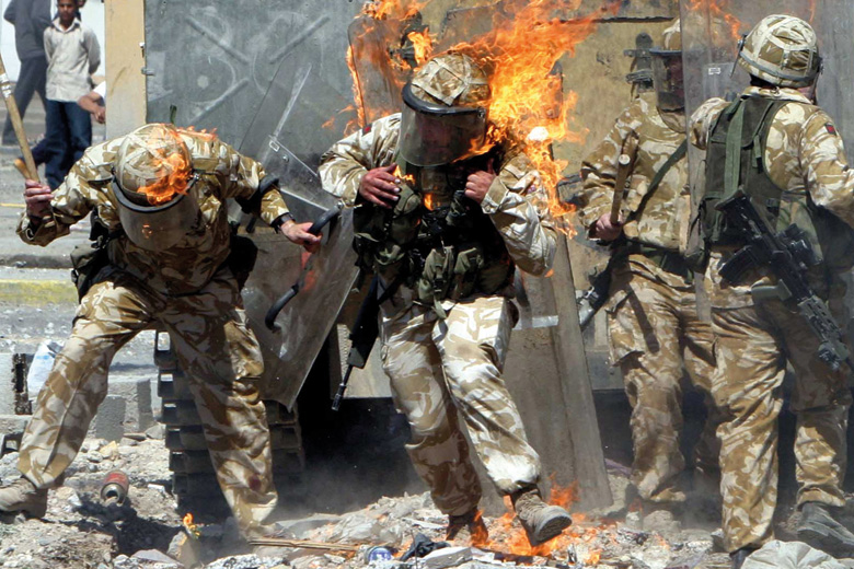 British Army troops covered in flames from petrol bomb, Basra, Iraq
