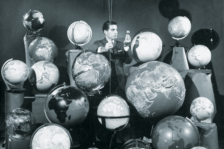 Businessman surrounded by globes of the world