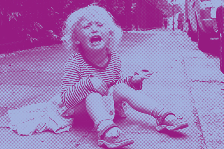 Child crying on the pavement