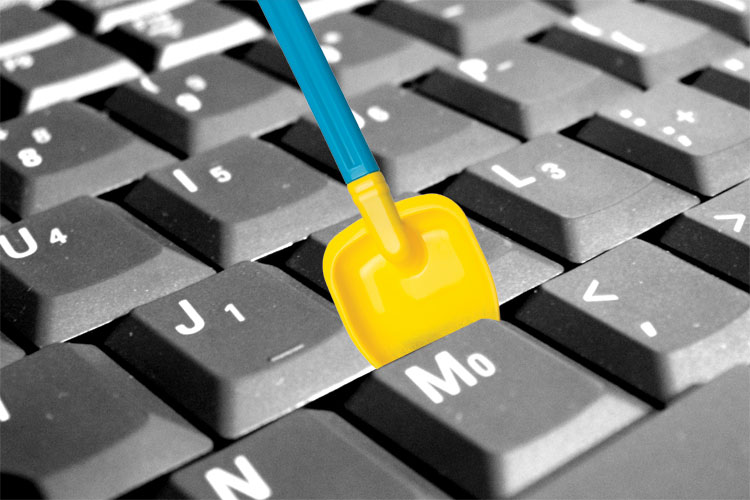 Child's spade stuck in keyboard