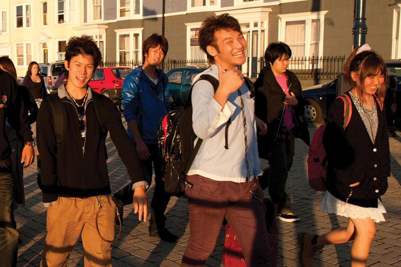 Chinese university students, Aberystwyth promenade, Wales