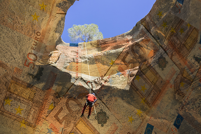 Person abseiling in canyon