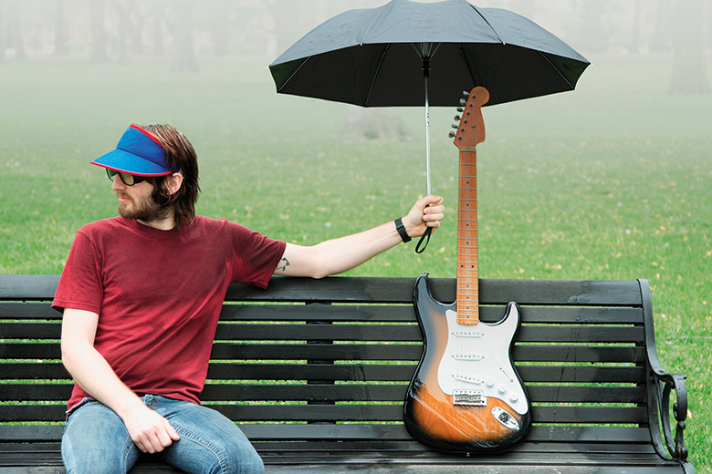 Covering a guitar with an umbrella