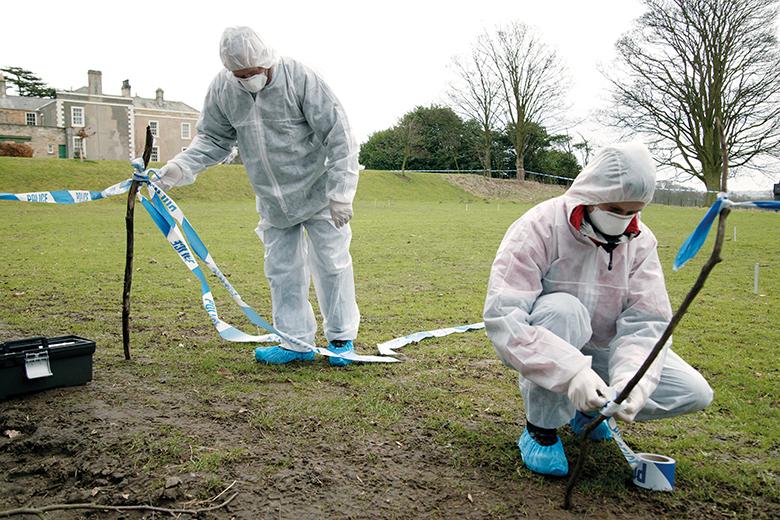 Forensic investigators at a crime scene