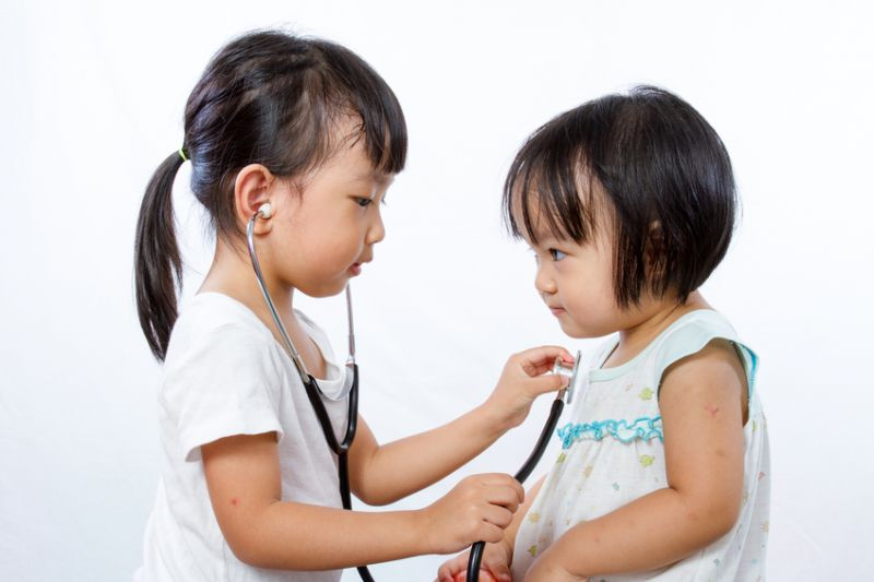 Girls playing doctors