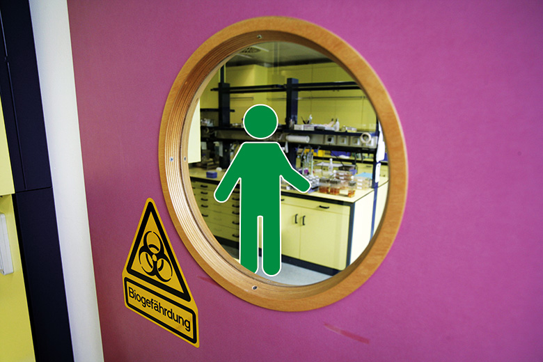 Green man working in a laboratory