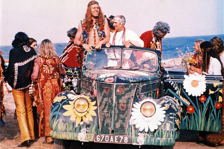 Group of hippies gathered around car