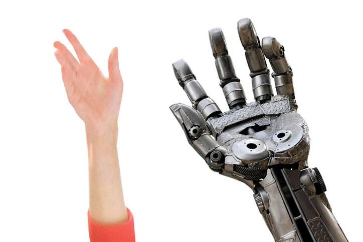 Human hand next to robot hand