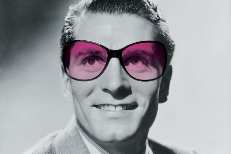 Laurence Olivier wearing purple sunglasses
