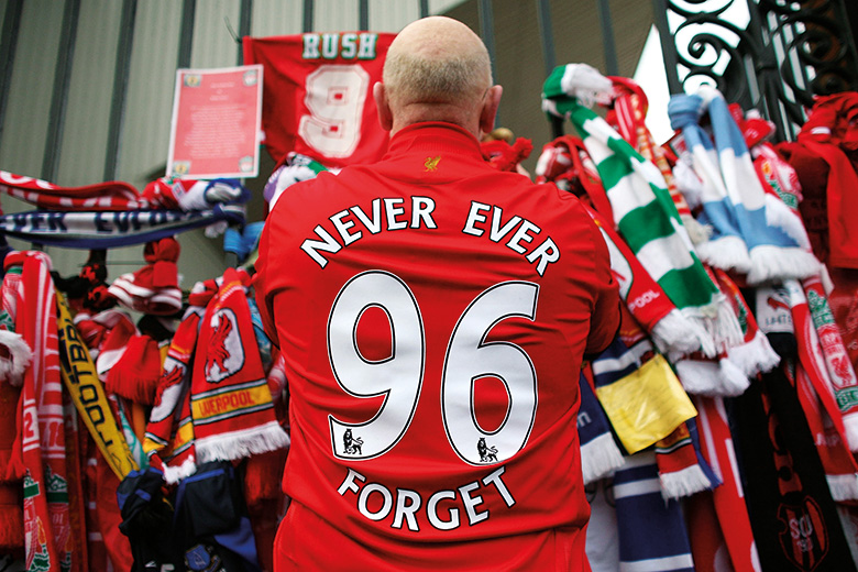 Liverpool F.C. football fan pays respects at Hillsborough memorial, Anfield