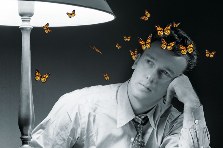 Man in thought surrounded by butterflies