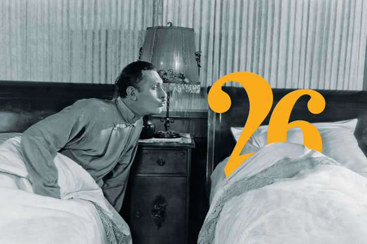 Man kissing number twenty-six in bed