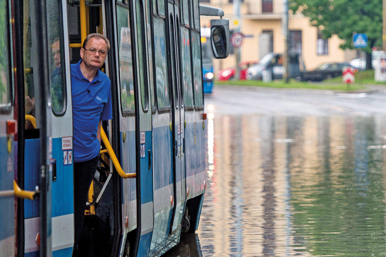 Man on tram stuck on flooded street, Wroclaw, Poland