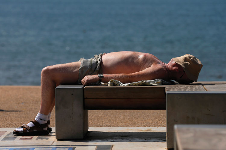 Man sunbathing, Blackpool, England