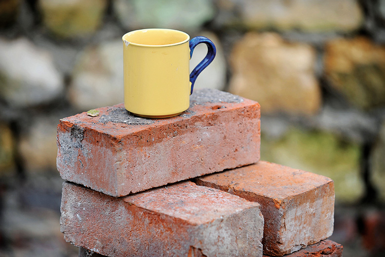 Mug on pile of bricks