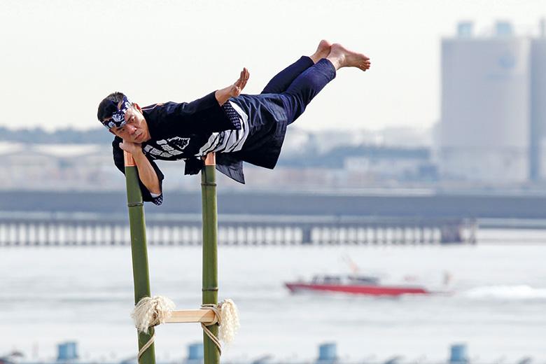 Ninja balancing on bamboo