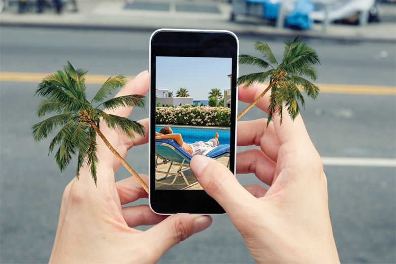 Person browsing holiday photos on smartphone screen
