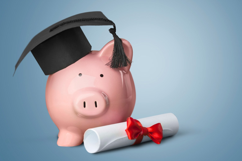 Piggy bank wearing mortar board (tuition fees)