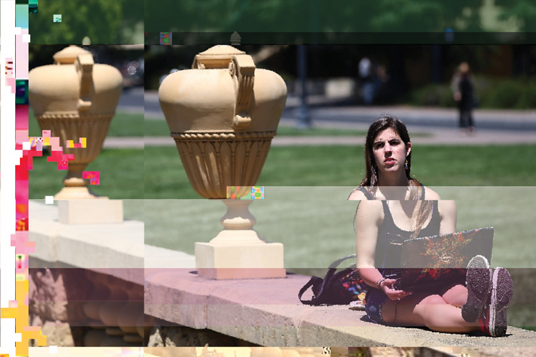 Poorly-downloaded photo of female Stanford University student
