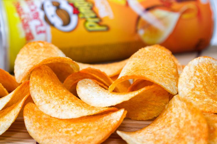 Pringles crisps spread on table