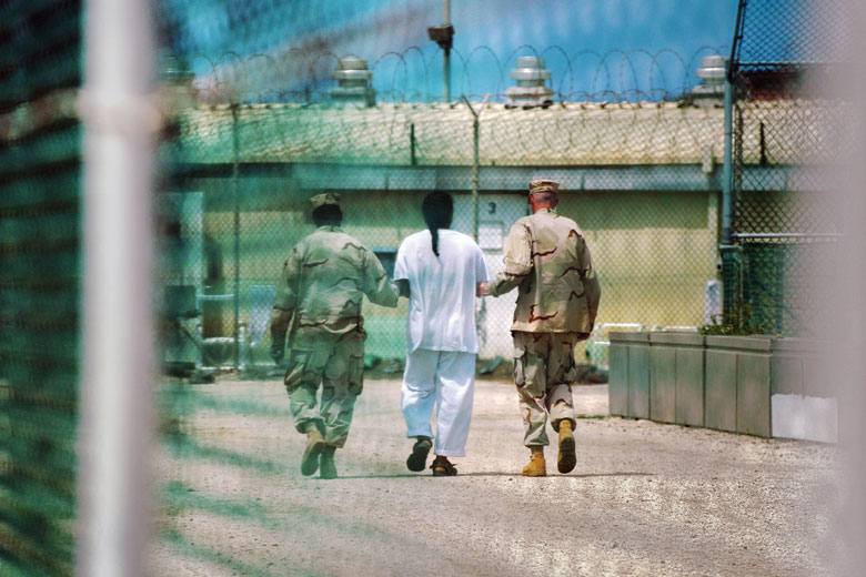 Prisoner being led by guards, Guantanamo Bay