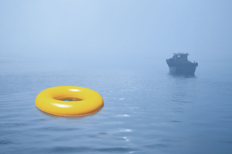 Rubber ring floating in misty waters