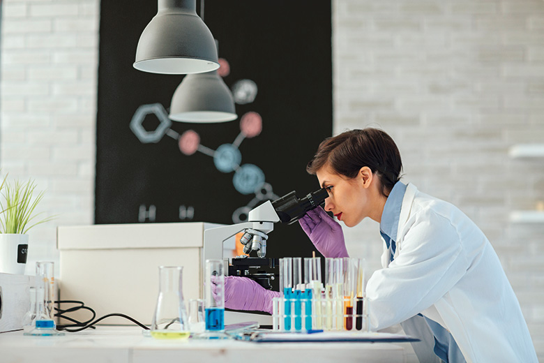 Scientist at a microscope