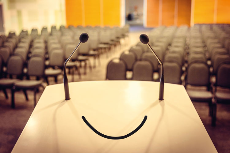 Smiling face on lecture hall podium
