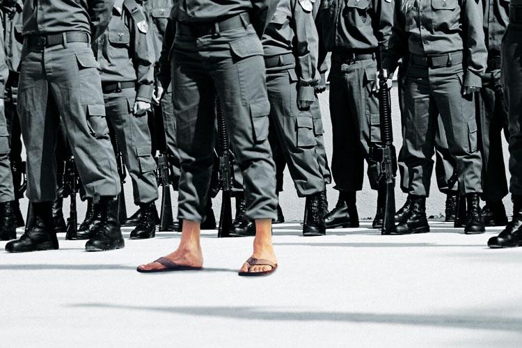 Soldier wearing flip flops