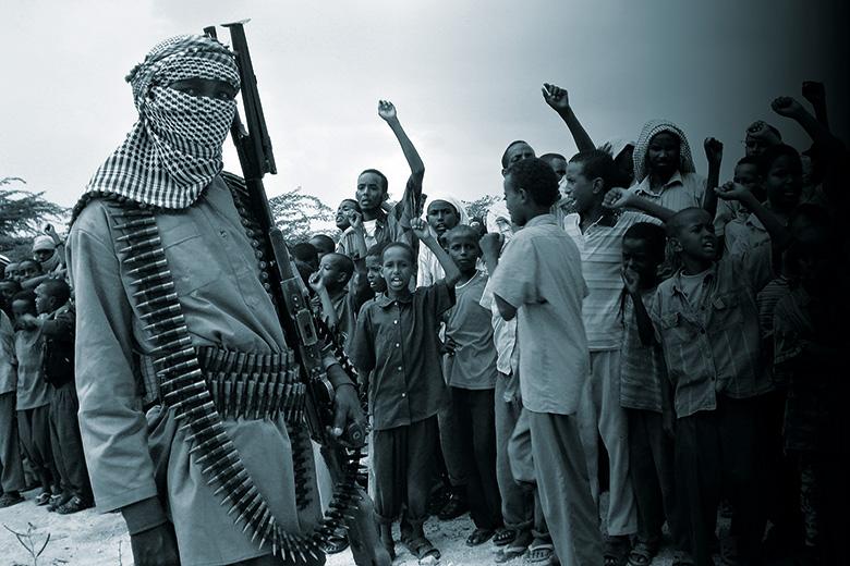 Somali boys chant as they watch parade of Al-Shabab Islamist fighters, Mogadishu