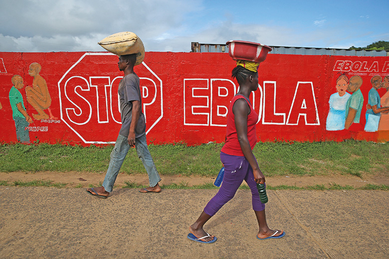 Stop Ebola sign written on wall