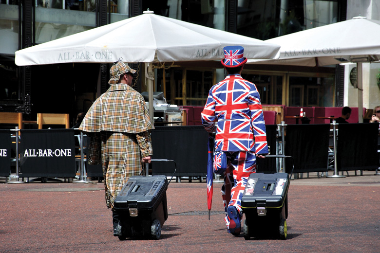 Street performers dressed in Sherlock Holmes and Union Jack costumes, London