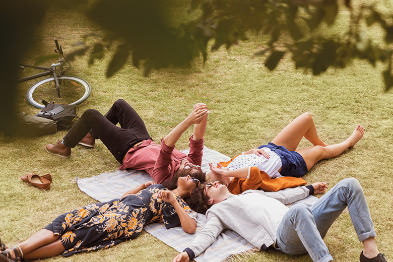 Students lying on the grass in a park