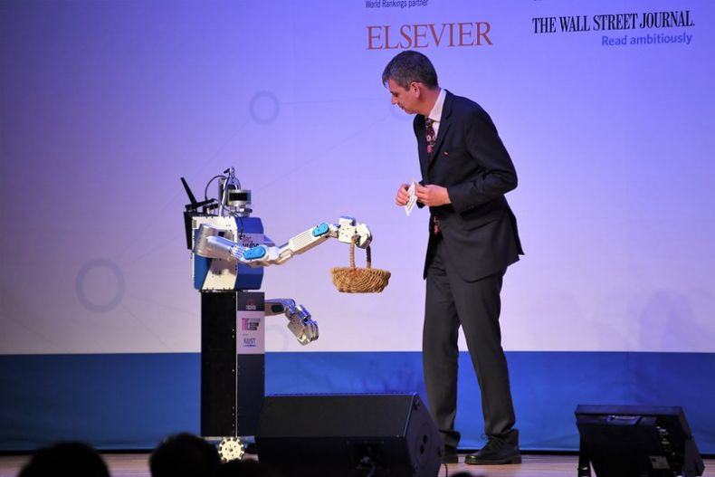 Robot interacting with presenter on stage