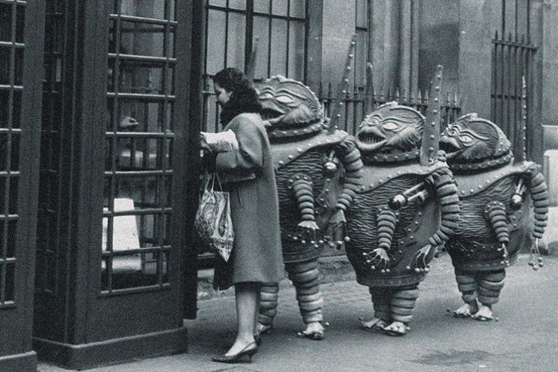 Aliens queuing outside a phone box