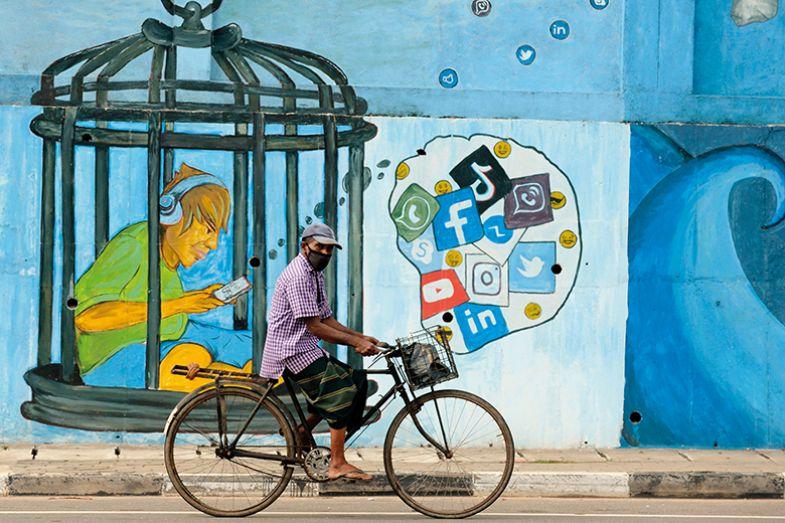 Man on bike in Sri Lanka