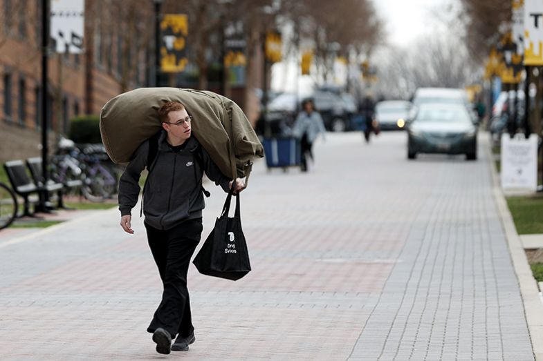 Student carrying belongings
