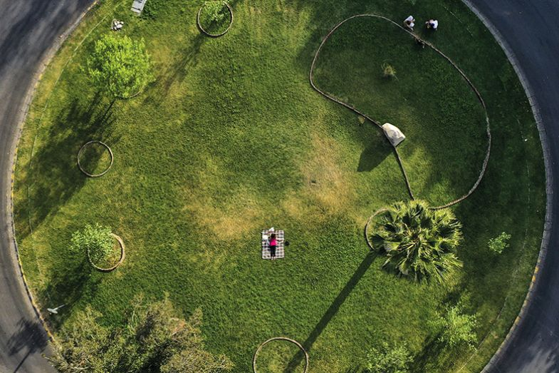 Aerial view of a woman at an empty park in Santiago on April 20, 2020