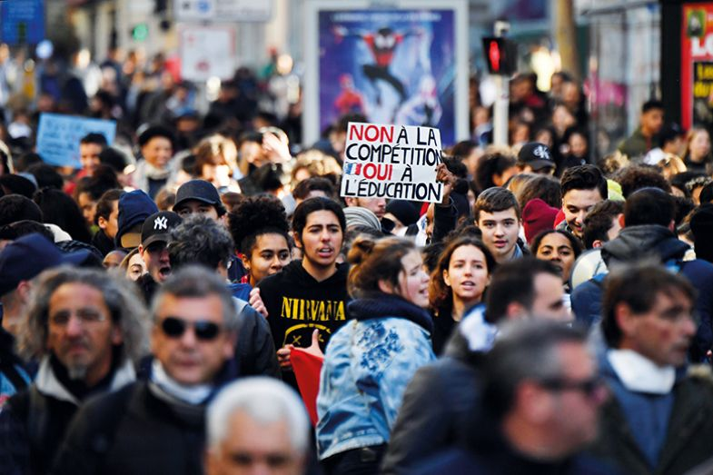 High school students take part in a demonstration in Marseille, southern France, against education reforms including stricter university entrance requirements
