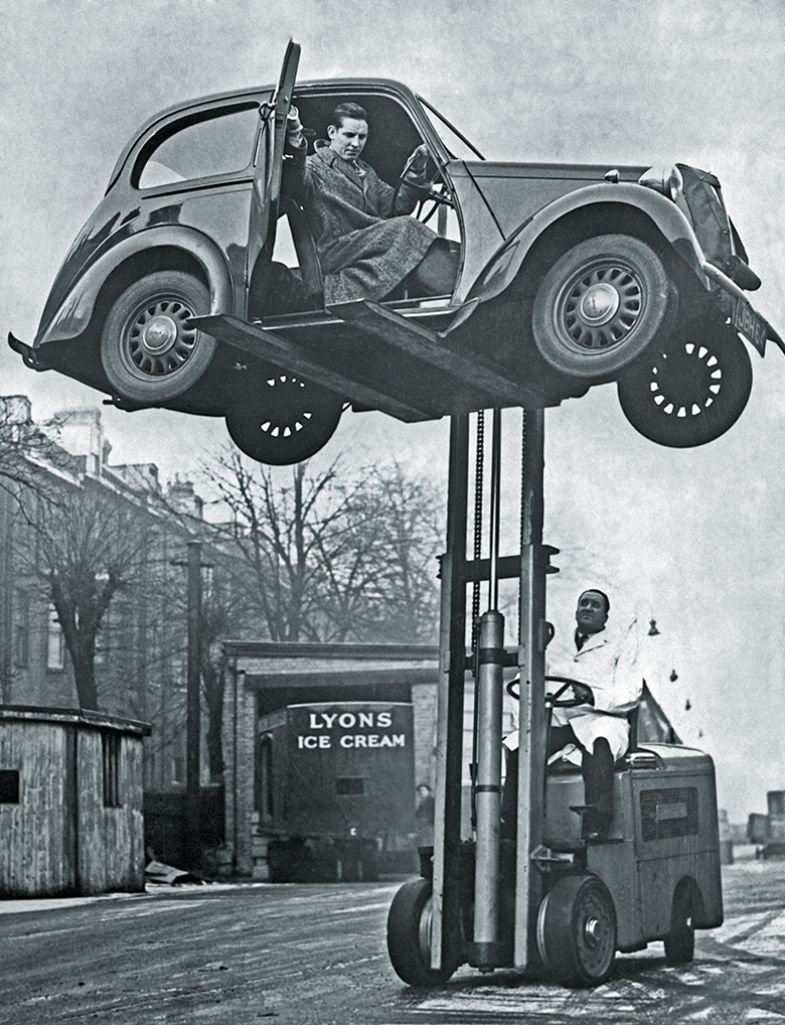 Forklift lifts car