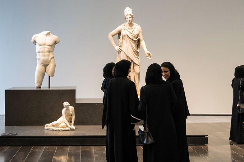 Women in Louvre Abu Dhabi Museum