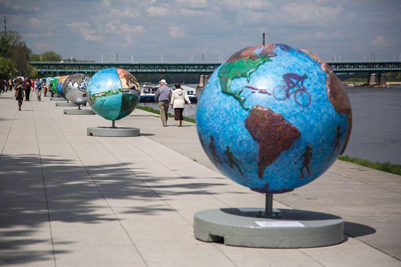 Globes on riverbank