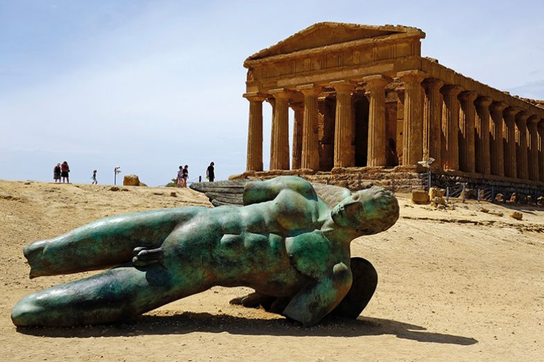 Sculpture of the fallen Icarus (2011) by the contemporary Polish artist, Igor Mitoraj, at the Temple of Concord in Agrigento