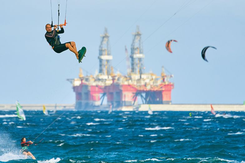 Kite surfer with tanker in the background