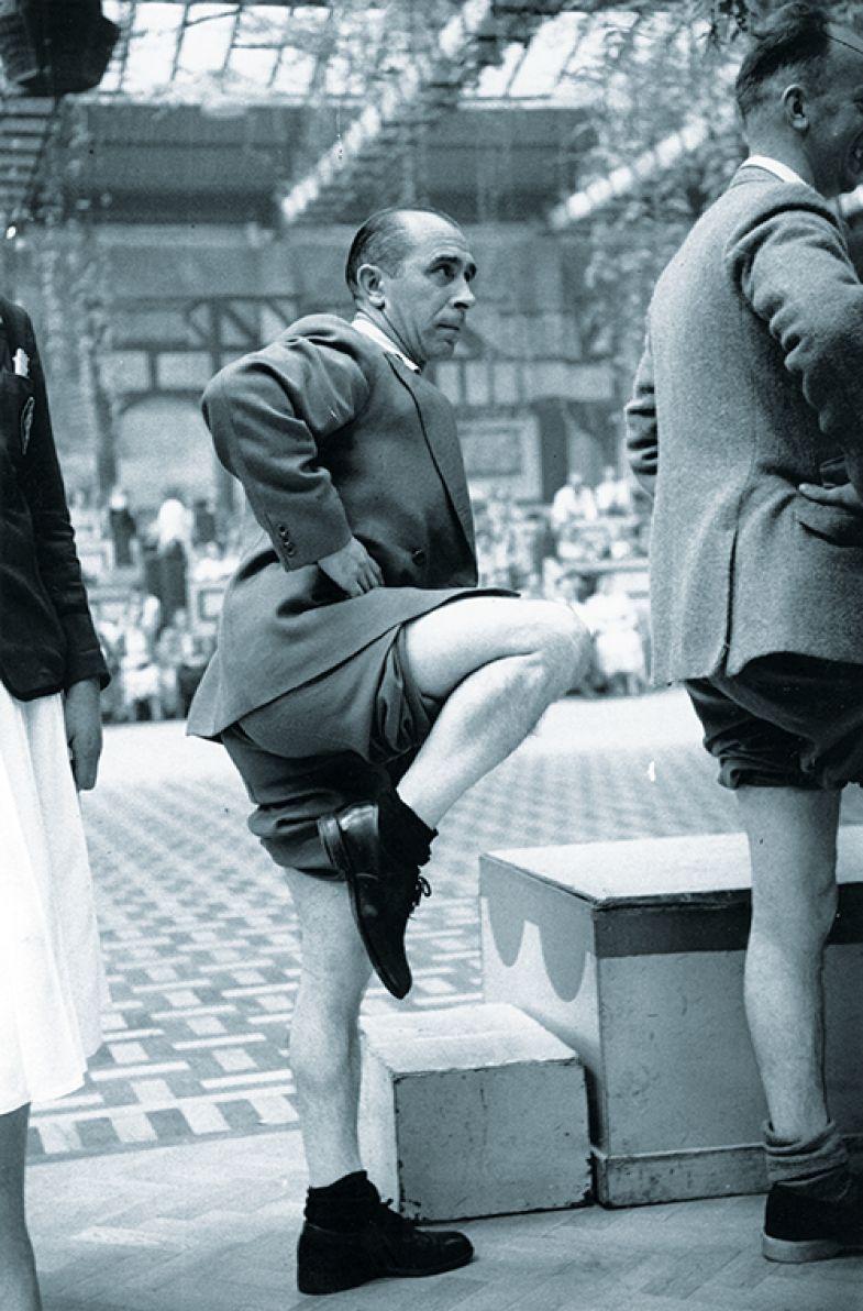 man balancing on one leg