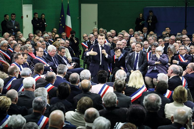 French president Emmanuel Macron addresses a gathering of some 600 mayors in the Normandy city of Grand Bourgtheroulde