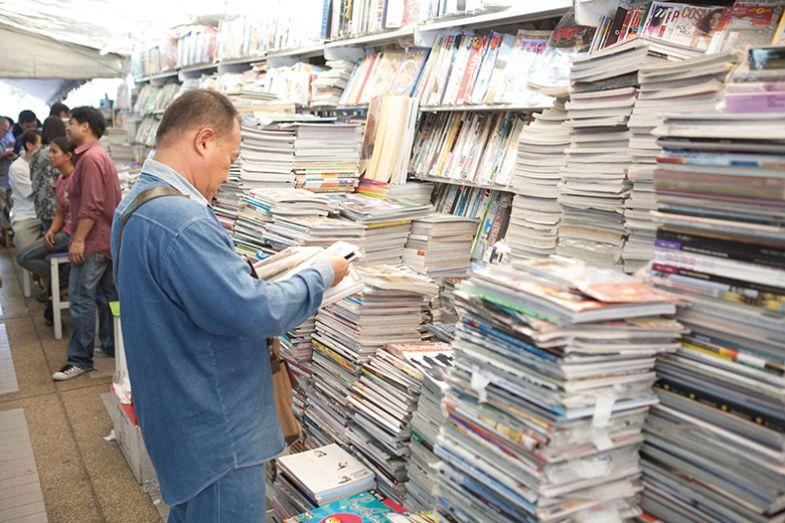 man reading magazines
